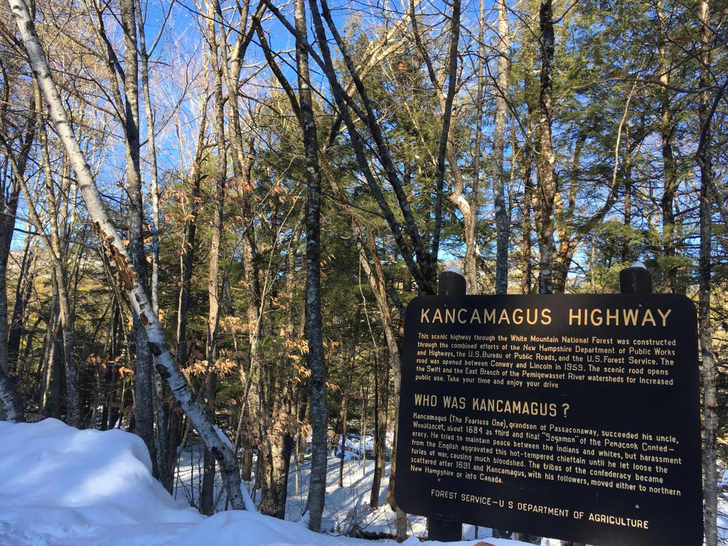 """New Hampshire State Route 112 is named for Chief Kancamagus, """"The Fearless One."""" Kancamagus was the last leader of the Pennacook Confederacy, a union of more than seventeen central New England Native American tribes, first forged by Kancamagus' grandfather, Passaconaway, in 1627. Kancamagus tried to maintain peace between his people and encroaching English settlers, but war and bloodshed forced the tribes to scatter, with most retreating to northern New Hampshire and Canada."""